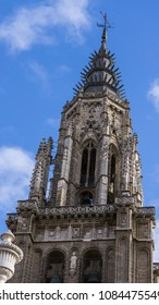 Details of the tower of Toledo's cathedral, Spain. Also in the picture little of the blue sky of the Spanish winter.