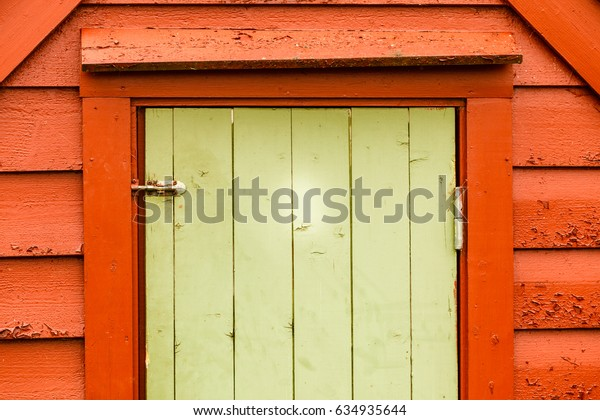 Details in traditional achitecture concept. Big green oldfashioned wooden doors in cottage house