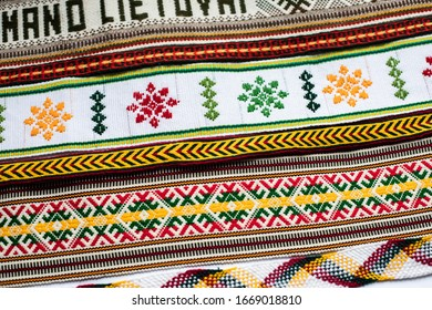 Details of a traditional colorful Lithuanian weave. Woven belts as a part of national Lithuanian costume worn on different festivals and occasions.National belt