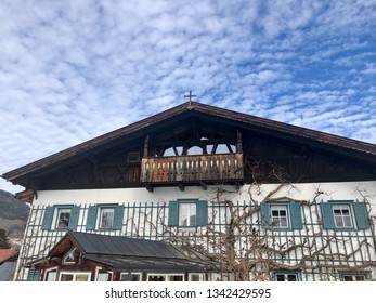 Details of a traditional farm house in Tirol, Austria, Europe against great cloudy blue sky