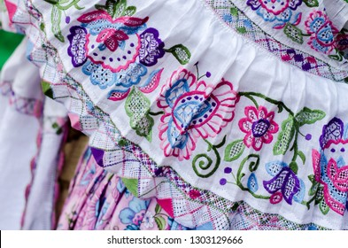 Details of the typical Panamanian dress known as pollera. The pattern is all handmade using different embroidery techniques