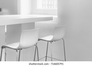 Details uncluttered white interior. White chairs and table.