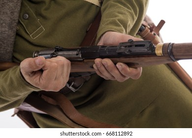 Details of the uniform of an ordinary soldier of the Russian army during the First World War, on a white background in the studio