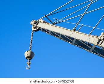 Details of upper part of an old crane: hook, chain, pulley, beam, rivets