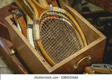Details of vintage wooden tennis rackets in a box. Landscape format.