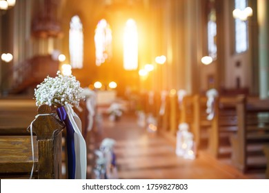 Details of the wedding day. Church Wedding decorations with plants and candles. Fine film grain texture.