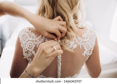 Details of the wedding day.A  beautiful bride is getting ready for the ceremony