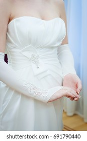 Details of the wedding dress and bride's hands ring