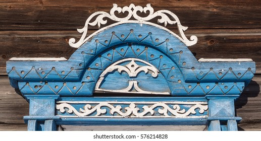Details of the window jamb. Traditional Russian house decoration facade. Close-up