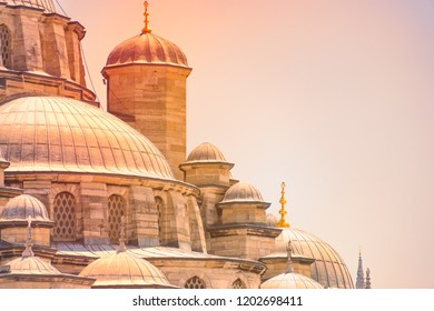 Details of Yeni Cami Ottoman imperial mosque located in the Eminönü quarter of Istanbul, Turkey. Sunset sky in background.