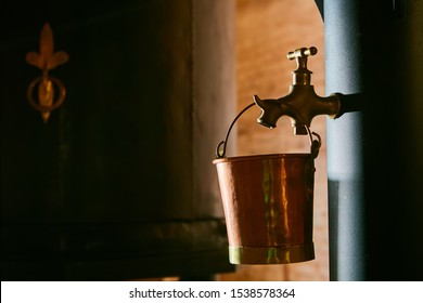 Detalis of medieval traditional distiller cube made from copper production of alcohol, cognac, whiskey. Fragment of copper old distiller for alcohol production. Ancient traditional food technologies