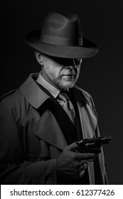 Detective holding a gun, he is wearing a fedora hat and a trench coat, 1950s noir film character
