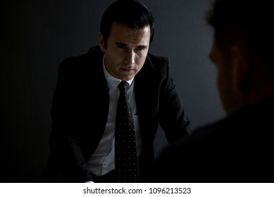Detective interview suspect or criminal man in interrogation room