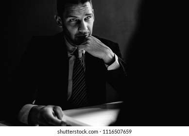 Detective interview suspect or criminal man in interrogation room in black and white tone