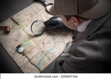 Detective man- magnifying glass, map of London, clock on chain