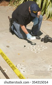 Detective studying a crimes scene taking photographs