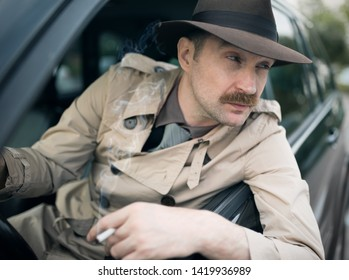 Detective waiting for someone in his car