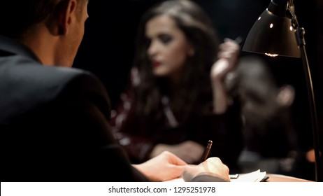 Detective writing confession of young woman, unraveling murder case, back view