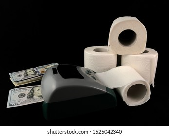 Detector for checking and counting banknotes. Making dollars from toilet paper. Fake American money. Concept: fake dollars, money trash.