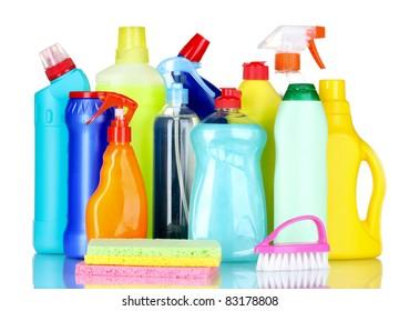 detergent bottles, brush and sponges isolated on white