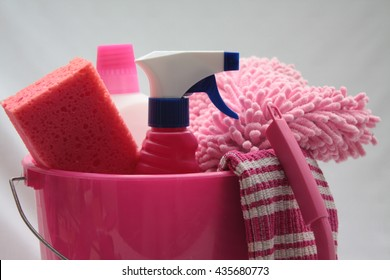 Detergent bottles in various sizes in a pink bucket