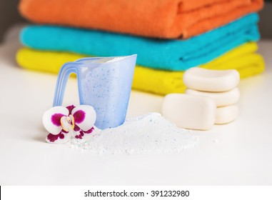 Detergent , towels and pieces of soap. Accessories for washing and cleaning