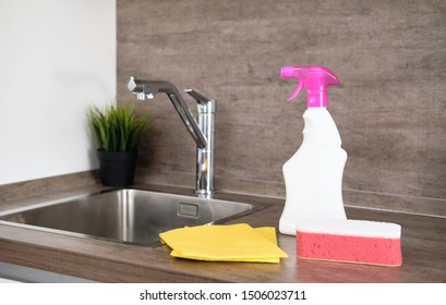 Detergents and cleaning accessories on kitchen. Cleaning and Washing Kitchen. Cleaning service concept.