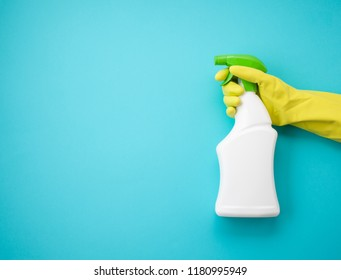 Detergents and cleaning accessories in pastel color. Cleaning service, small business idea, spring cleaning concept. Flat lay, Top view.