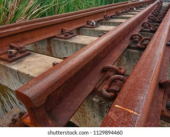 Deteriorate of old cement railroad sleepers and rusty railroad steel has expired