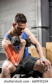 Determinated male athlete doing excercise with dumbbells at gym