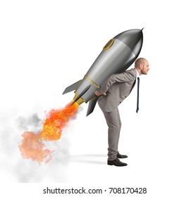 Determination and power businessman that holds a rocket isolated on white background