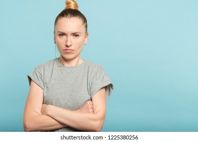 determined assertive serious woman with crossed arms. strong personality.