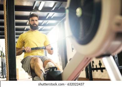 Determined bodybuilder rowing.