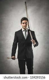 determined businessman with bow and arrow