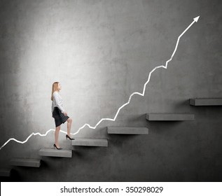 determined businesswoman in the spotlight climbing a carrer ladder, positive trend at the back, dark background, concept of success and career growth