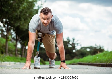 Determined disabled man feeling confident while standing on the track