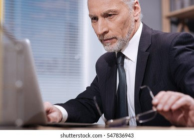 Determined executive using his laptop