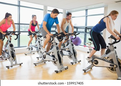 Determined five people working out in gym