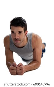 Determined sports player exercising planks against white background