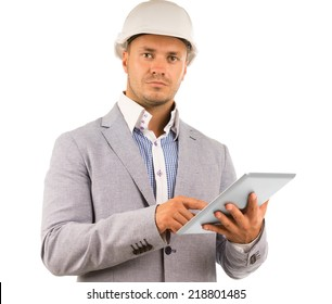 Determined young architect staring to the side of the camera with a serious expression while holding a tablet computer in his hand, isolated on white