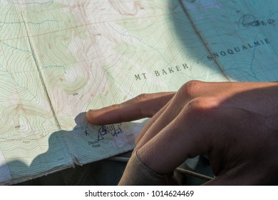 Determining location on a topographic map in the North Cascade mountains in Washington.