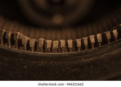 A detialed macro image of the tops of a vintage typewriter's keys