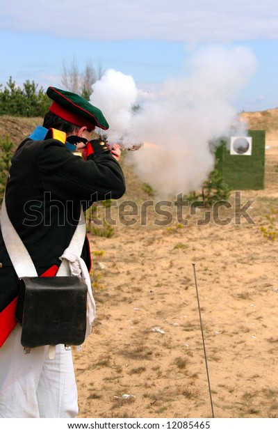 detonating fuse moment of gun fire performed with weapon used by French army in times of Napoleon Bonaparte