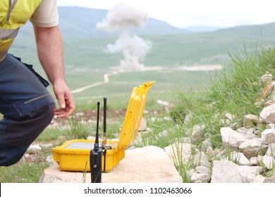 detonator box of yellow color intended for detonating explosives