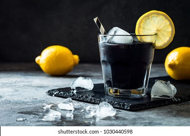 Detox activated charcoal black lemonade. Copy space.