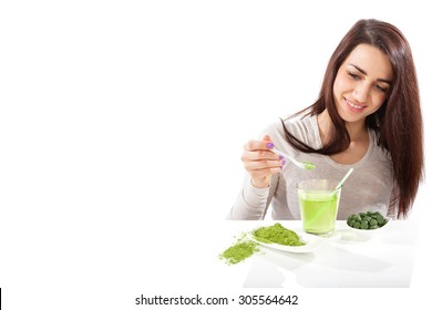 Detox. Beautiful girl with green drink in hand isolated on white. Spirulina, chlorella and wheatgrass. Healthy lifestyle, detox.