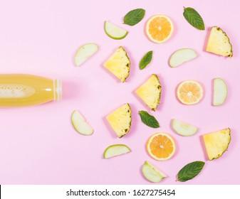 detox bottle and vegatables, fruits on the pink background