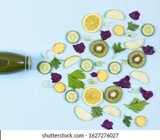 detox bottle and vegatables, fruits on the blue background