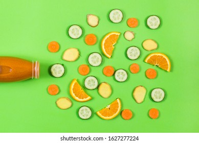 detox bottle and vegatables, fruits on the green background