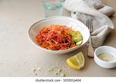Detox carrot salad with apple, beetroot and avocado. Light background